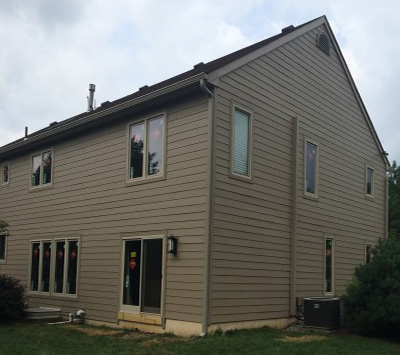 Installed Hardie siding, trim and insulation.