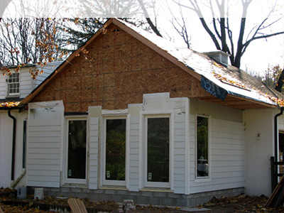 Hardie plank cement siding installed with insulation.